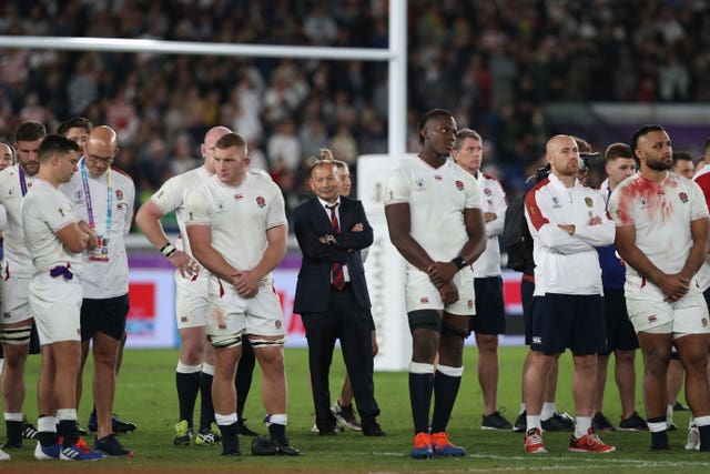 Eddie Jones (centre) and England players after the World Cup final