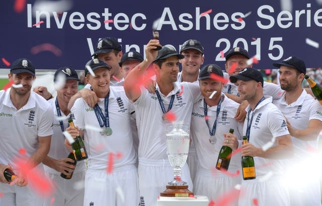 England captain Alastair Cook lifts the Ashes Urn after victory in 2015