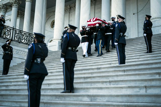 The coffin of US Capitol Police officer William 'Billy' Evans is carried from the Capitol by a joint services honour guard in Washington