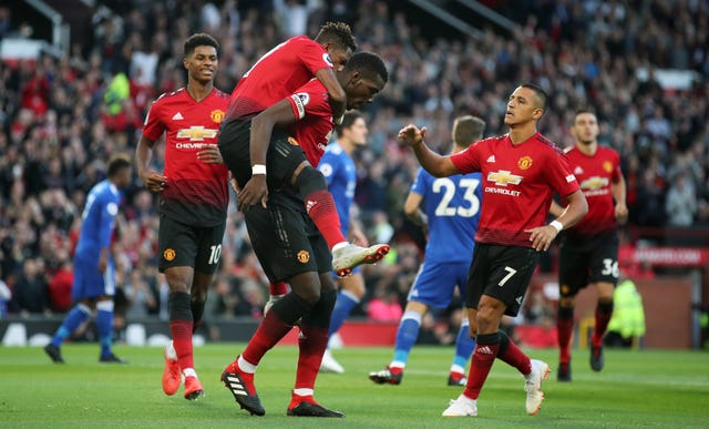 Manchester United's Paul Pogba (centre left) celebrates