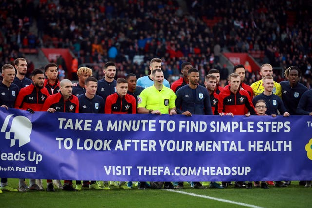 Southampton and Huddersfield players show their support for the Heads Up campaign