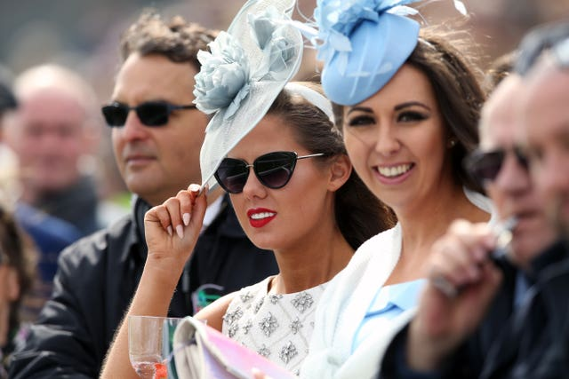 Racegoers watch the action during Ladies Day at Aintree