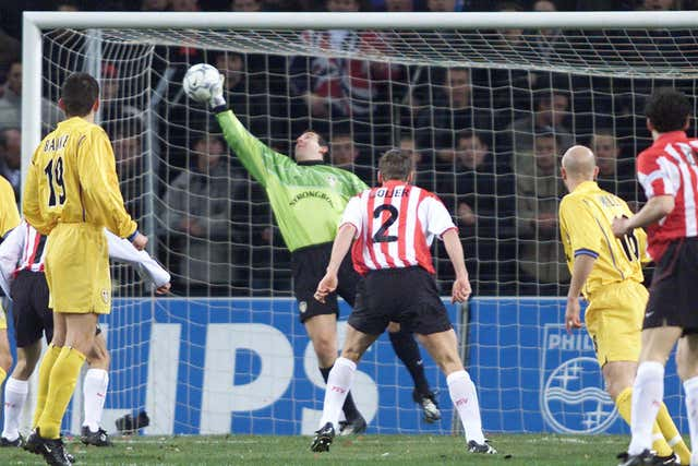 Nigel Martyn makes a save for Leeds in the UEFA Cup against PSV