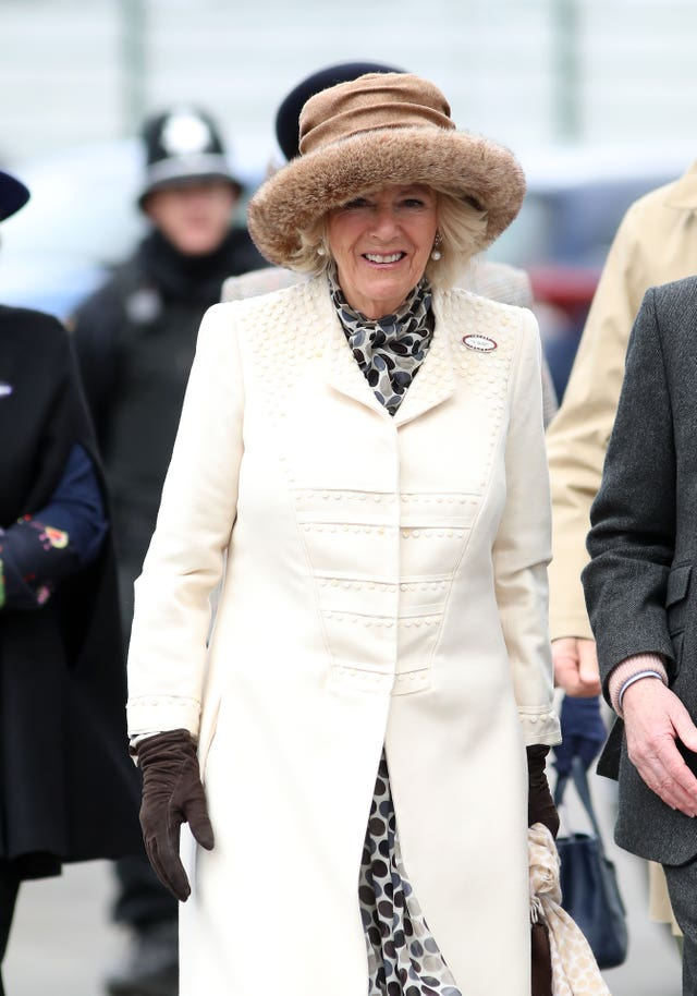 The Duchess of Cornwall arrives ahead of Ladies Day of the 2019 Cheltenham Festival at Cheltenham Racecourse.