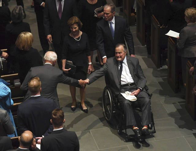 Former President George H W Bush shakes mourners hands at the funeral (Jack Gruber/AP)