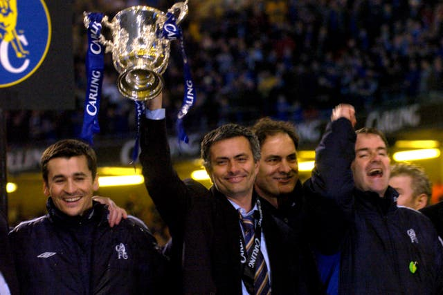 Mourinho holds up his first silverware as Chelsea boss following a Carling Cup final win over Liverpool