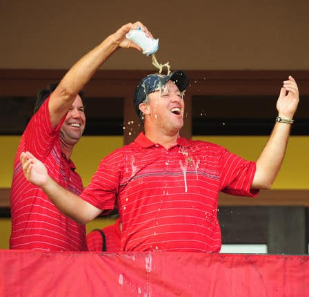 USA captain Paul Azinger pours a drink over Boo Weekley