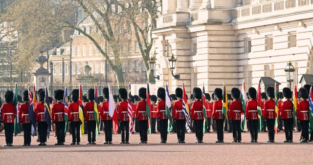 A Guard of Honour turns out on the forecourt of Buckingham Palace (Gareth Fuller/PA)