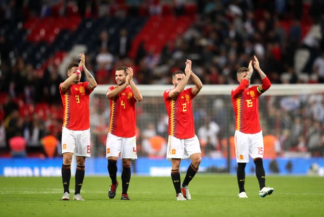 Spain's players applaud the fans after their victory over England
