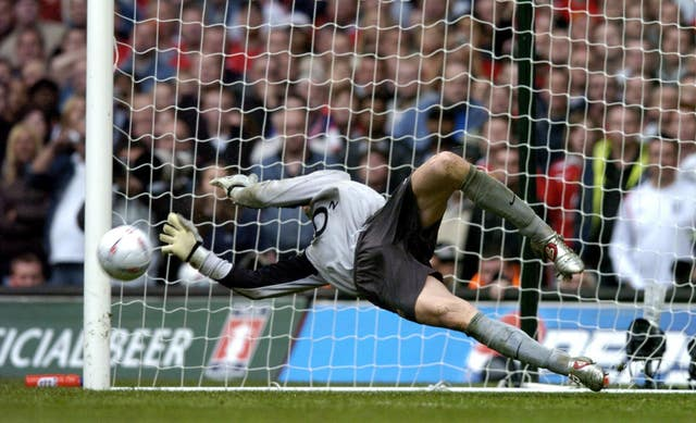 Jens Lehmann saves Paul Scholes's spot kick as Arsenal became the first club to win the FA Cup after a penalty shoot-out in 2005