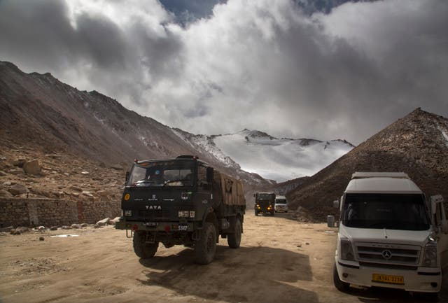 An Indian Army lorry crosses Chang la pass near Pangong Lake in Ladakh (Manish Swarup/AP)