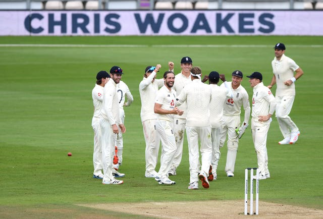 England's Chris Woakes  celebrates the wicket of Pakistan's Mohammed Rizwan