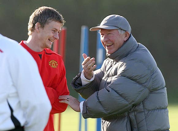 Ole Gunnar Solskjaer, right, says it has been a while since he last spoke to Sir Alex Ferguson (Martin Rickett/PA)