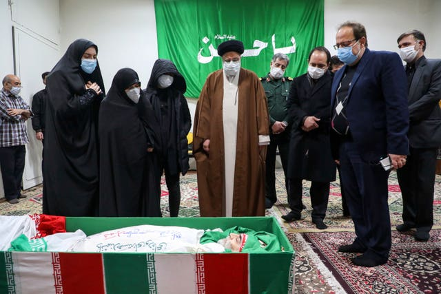 Iran's judiciary chief Ayatollah Ebrahim Raisi pays his respect to Mohsen Fakhrizadeh