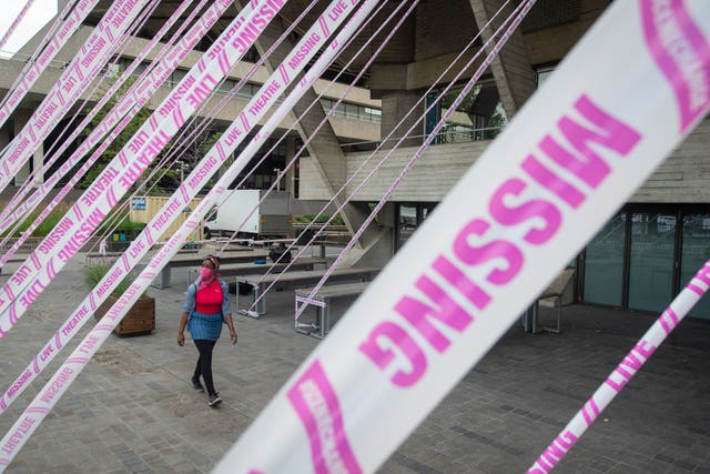 The National Theatre is wrapped in tape as part of a campaign to draw attention to the plight of UK theatre