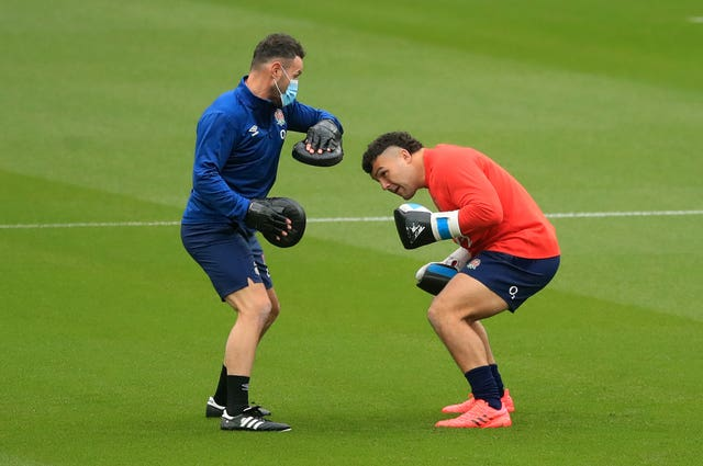Genge does some boxing practice during England training at Twickenham