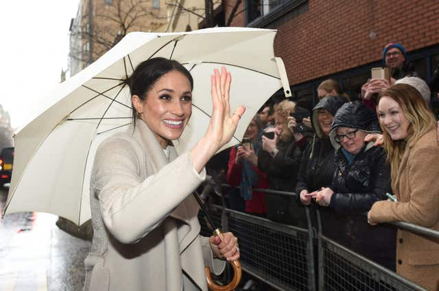 The rain did not dampen Meghan's spirits (Joe Giddens/PA)