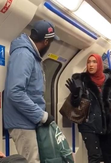 A woman in a hijab defending the Jewish family who was being harassed
