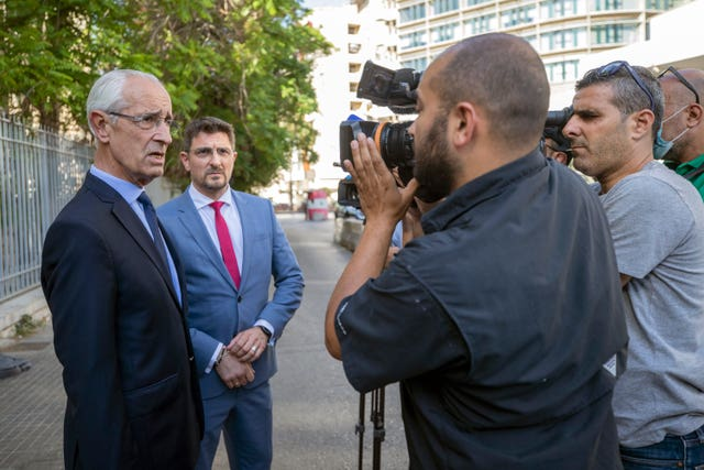 Jean Yves Le Borgne, left, talks to journalists in front of the Palace of Justice in Beirut, Lebanon