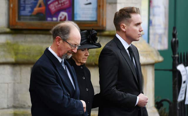 Jane Hawking, the first wife of Professor Stephen Hawking and their son Timothy (right), leave following his funeral at University Church of St Mary the Great in Cambridge