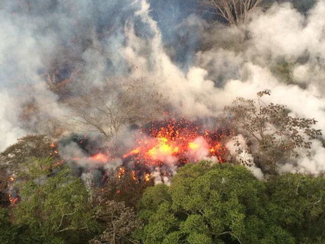 Lava spattering from an area on the lower east rift of the Kilauea volcano (US Geological Survey via AP)