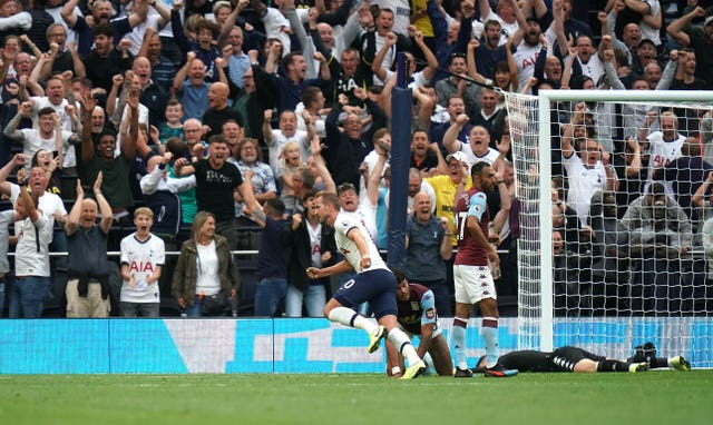 Harry Kane, centre, scored a late double to help Tottenham to a 3-1 win at home to Aston Villa