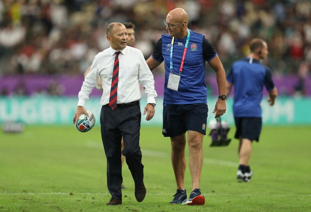John Mitchell (right) is to stay with England until 2021