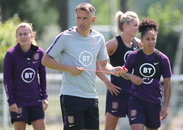 England head coach Phil Neville is not concerned by the surprise visit of USA officials to his team's hotel