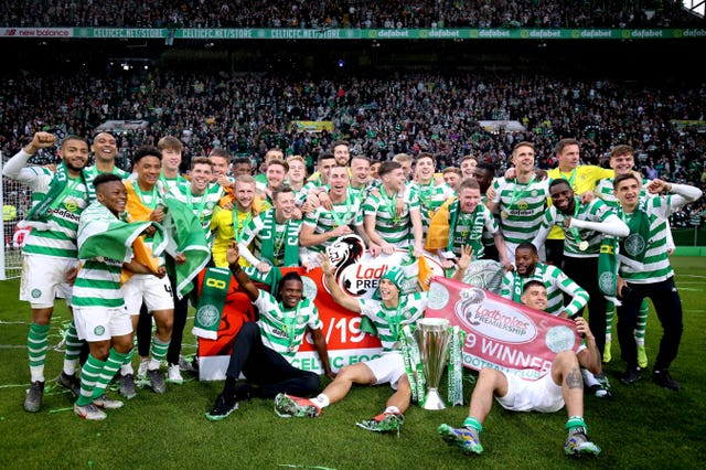 Celtic players celebrate with the trophy