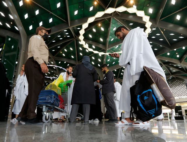 People arrive for the hajj