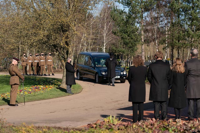 The funeral cortege arrives for the service