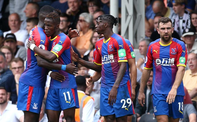 Wilfried Zaha, centre left, celebrates a goal with team-mates including Aaron Wan-Bissaka, centre