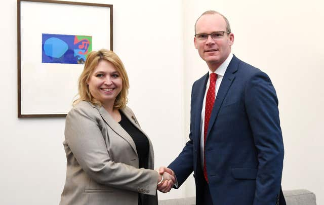 Irish Foreign Affairs Minister Simon Coveney shakes hands with Northern Ireland Secretary Karen Bradley at the Northern Ireland Office in Westminster, London (Stefan Rousseau/PA)