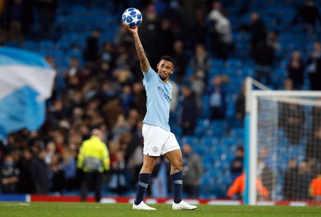 Manchester City's Gabriel Jesus celebrates with the matchball