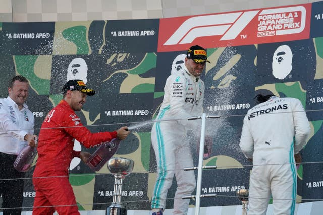 Hamilton, right, shares the podium with Valtteri Bottas, centre, and Sebastian Vettel
