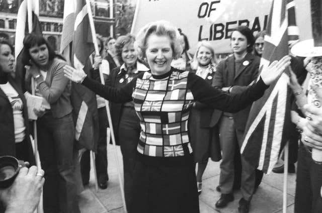 Margaret Thatcher, sporting a sweater bearing the flags of European nations, in Parliament Square during her 'Yes to Europe' campaign (PA)