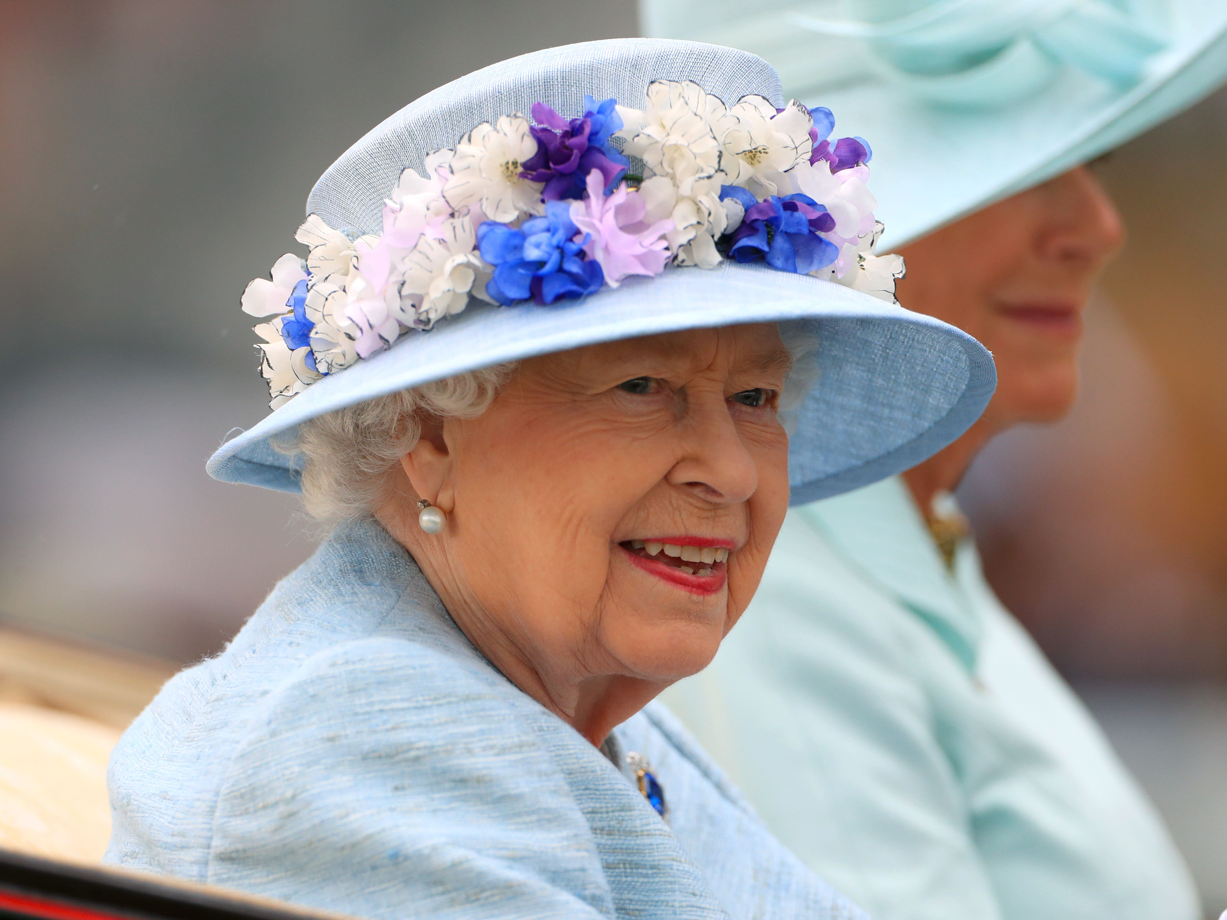 The Queen looked happy in the procession (Mike Egerton/PA)