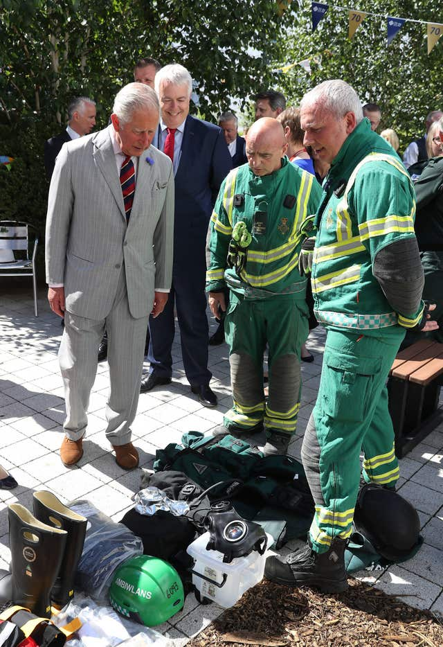 Charles meets an ambulance crew on the fourth day of his tour of Wales