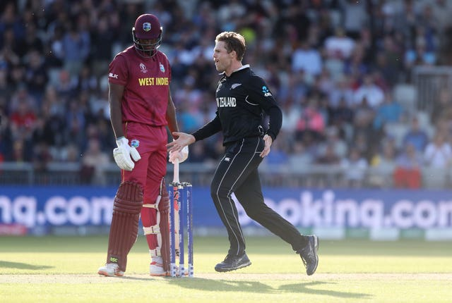Lockie Ferguson, right, celebrates the dismissal of West Indies captain Jason Holder