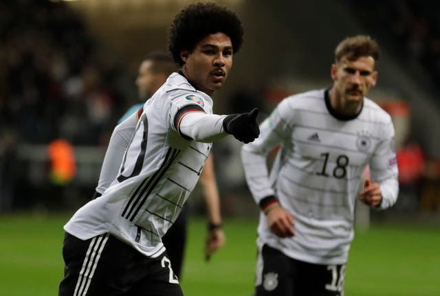 Serge Gnabry, left, celebrates  one of his three goals