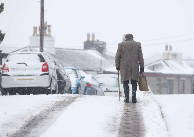 For some it proved easier to walk than drive in the snowy conditions (Owen Humphreys/PA)
