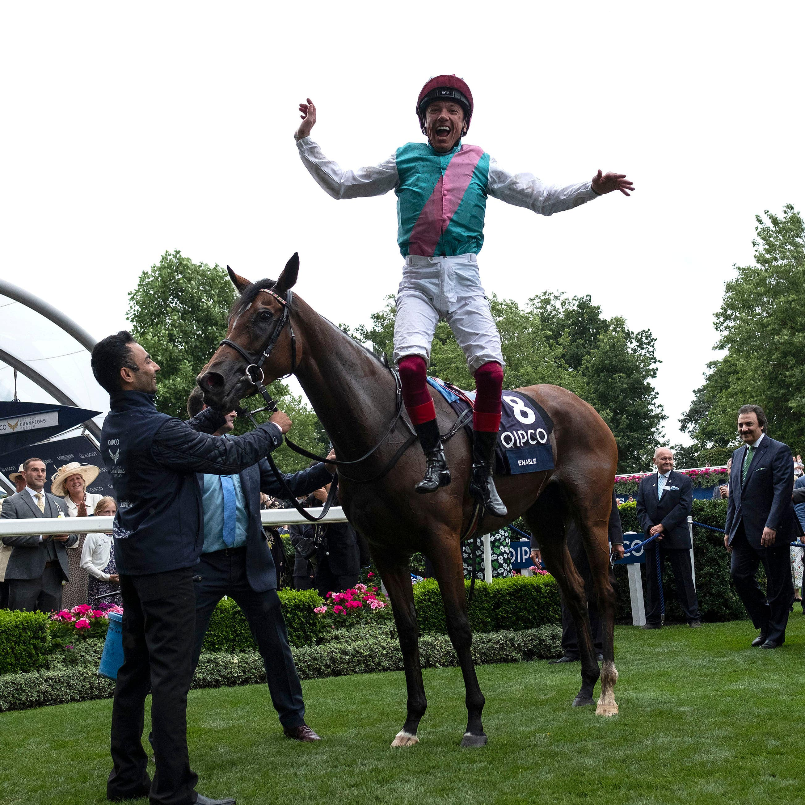 Frankie Dettori jumps from Enable after winning the King George