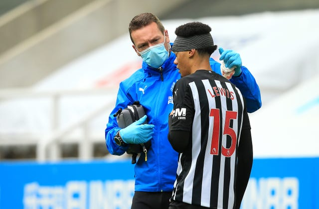 Newcastle's Jamal Lewis received treatment for a head injury against Brighton