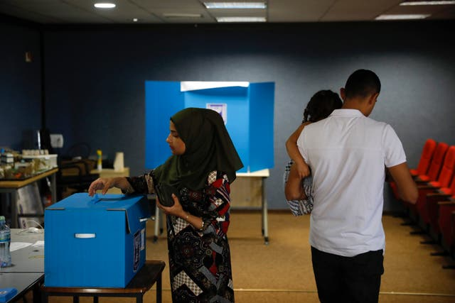 A woman votes in Kfar Manda, an Arab town in Israel