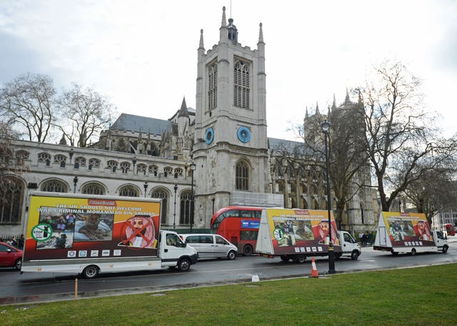 Three billboards protesting against the visit are driven around Parliament Square (Kirsty O'Connor/PA)