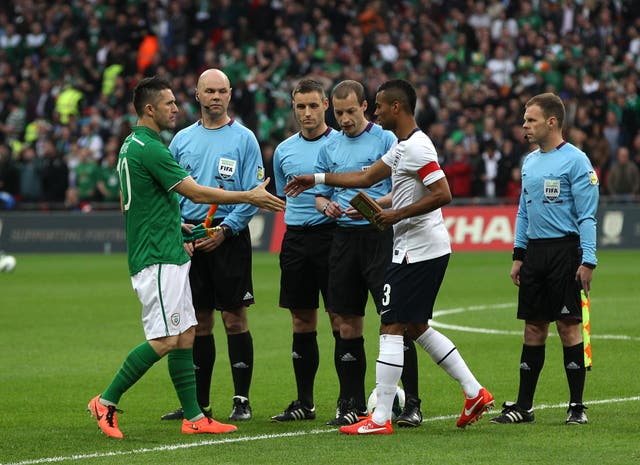 Ashley Cole, right, shakes hands with Republic of Ireland captain Robbie Keane