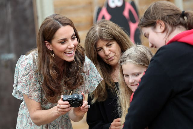 The Duchess of Cambridge during a visit to a Royal Photographic Society workshop with Action for Children in Kingston upon Thames