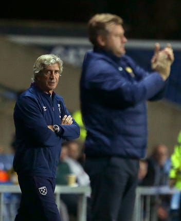 Manuel Pellegrini, left, and Oxford manager Karl Robinson
