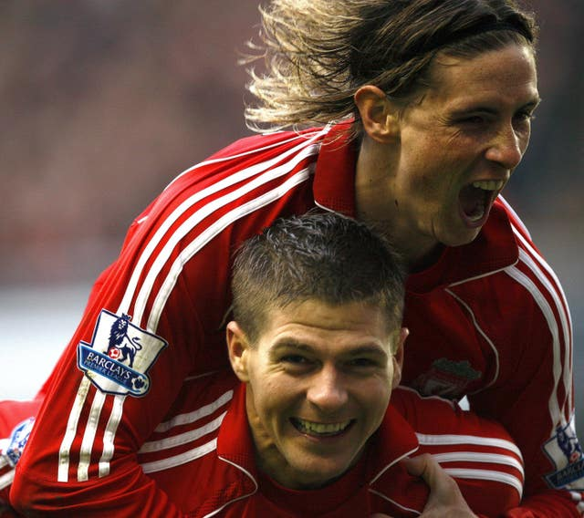 Fernando Torres, top, congratulates Steven Gerrard on a goal against Newcastle