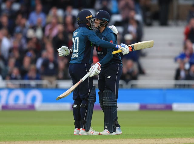 Roy celebrates his century with Joe Root (right)